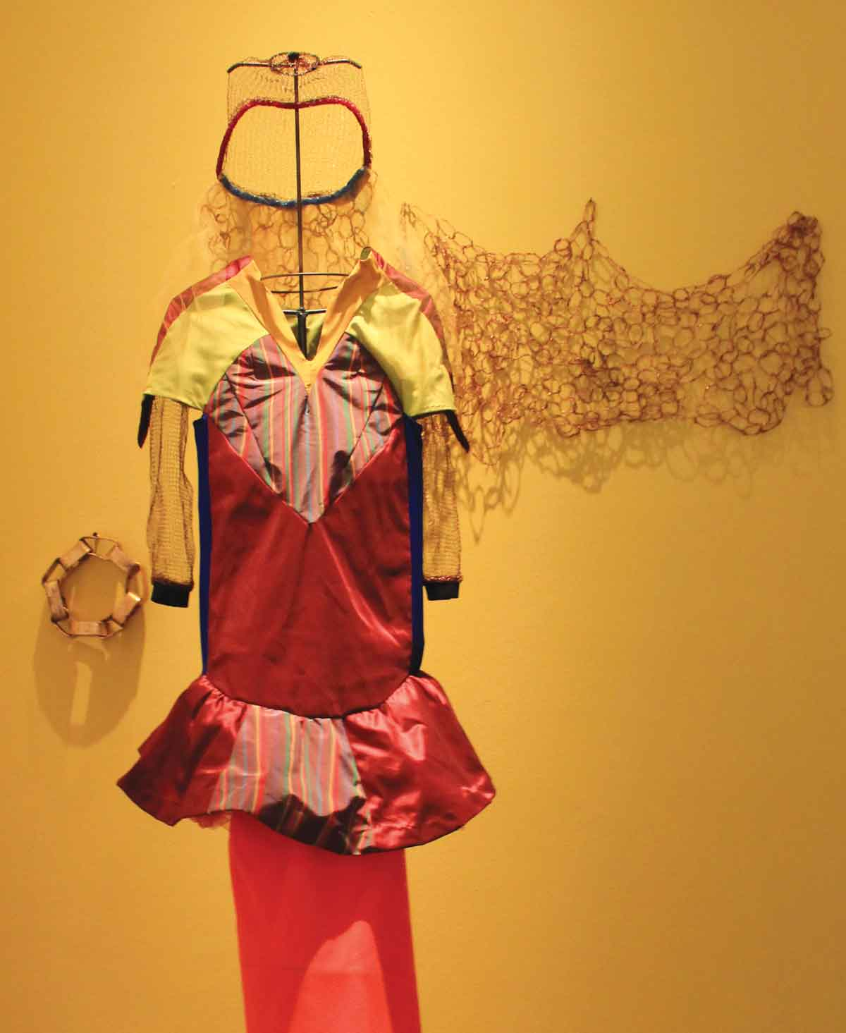"Jody Culkin, Uni, 2009, fabric, steel, copper mesh, elastic, and broken glass, 80"" x 21"" x 18."" Courtesy of the artist and the Boca Raton Museum of Art."