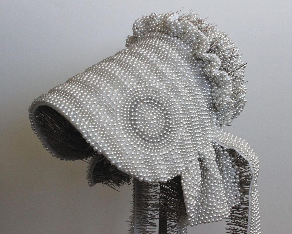 Angela Ellsworth, Seer Bonnet: Clarissa (age 15), 2012-2013, 17,443 pearl corsage pins, fabric, steel. Courtesy of the artist and Lisa Sette Gallery, Scottsdale.