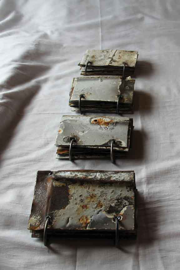 "Verónica Vides, Libros de cocina (Stove Books), 2013, fragments of a stove from a burned down home, 3.93"" x 5.9"" x 1.57."""