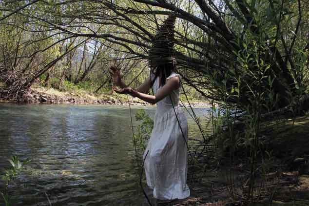 "Verónica Vides, ""Mimetizada"" series, Primavera (Spring), 2013-15, photography, performance, 23.6"" x 15.8."" Thanks to Luz Martínez."