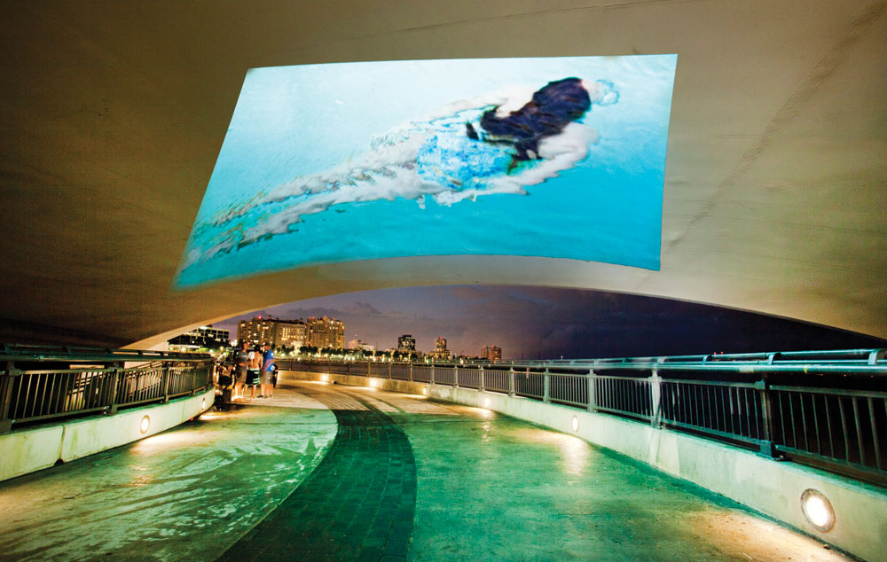 Cheryl Maeder, Submerge, video projected on the ceiling under the Royal Park Bridge, West Palm Beach, FL, Canvas Outdoor Museum 2015. Photo: Cheryl Maeder Photography.