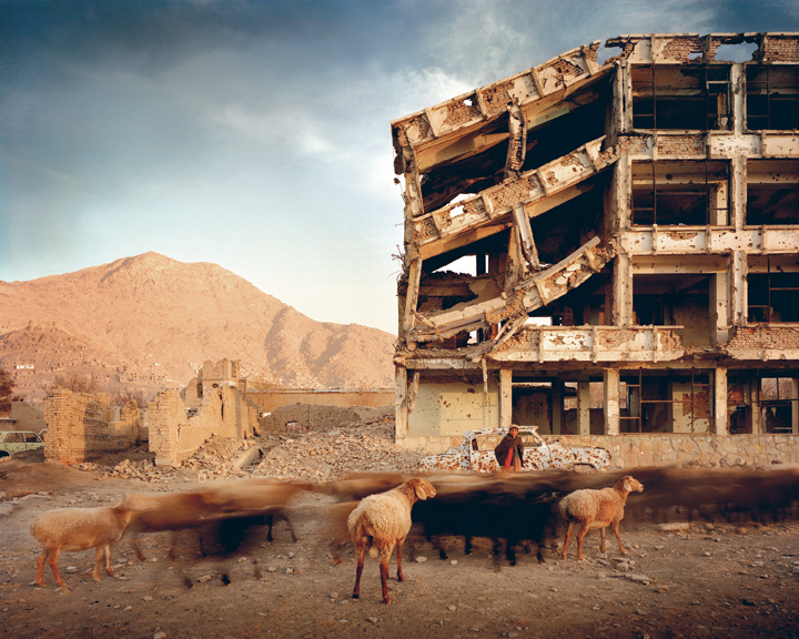 Simon Norfolk, Bullet-Scarred Apartment Building and Shops, Karte Char District, Kabul, Afghanistan, loan and image courtesy of the photographer and Gallery Luisotti, Santa Monica, CA