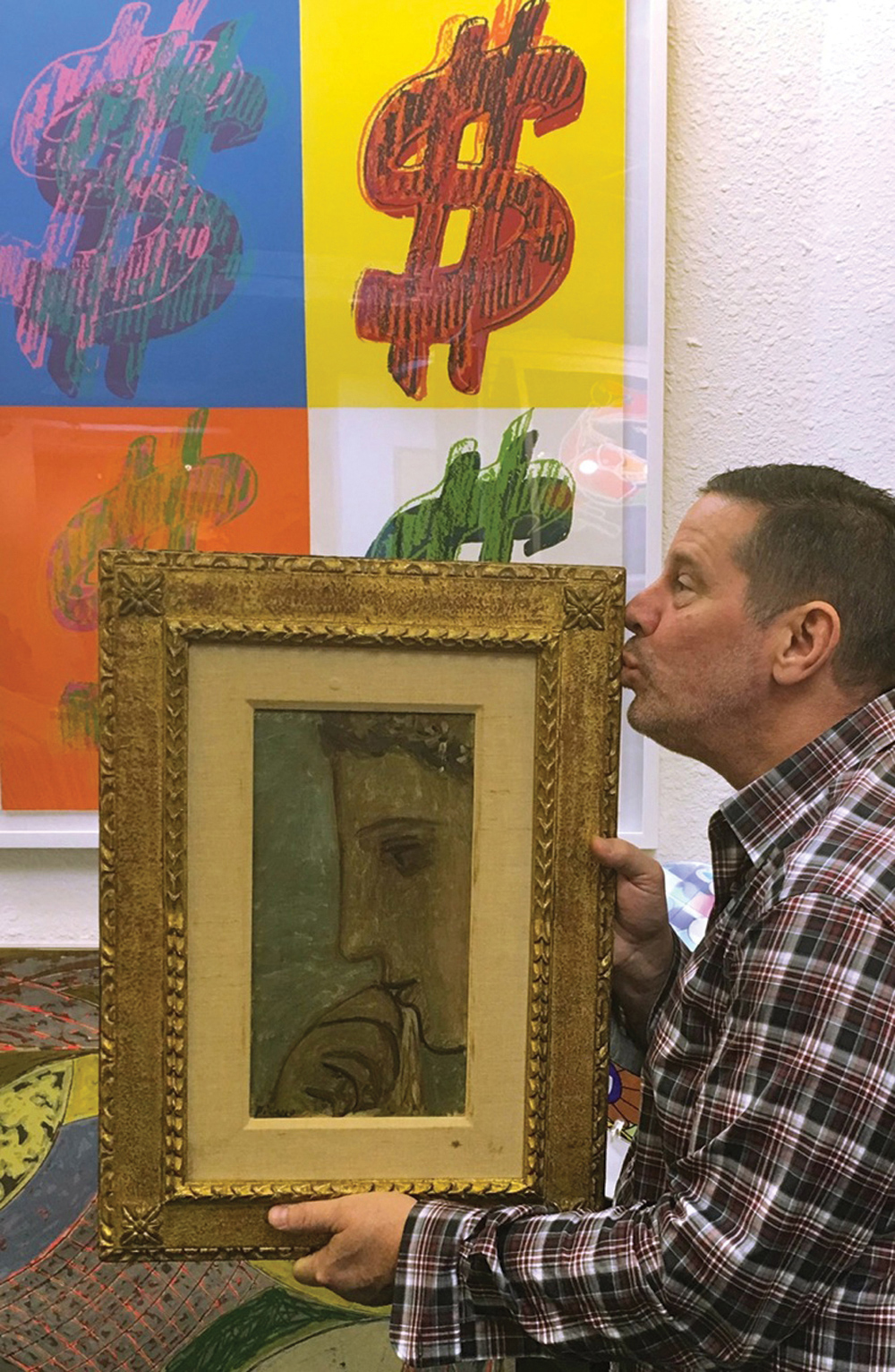Ken Hendel of Gallery Art in Aventura kissing his Picasso. Courtesy of Ken Hendel.