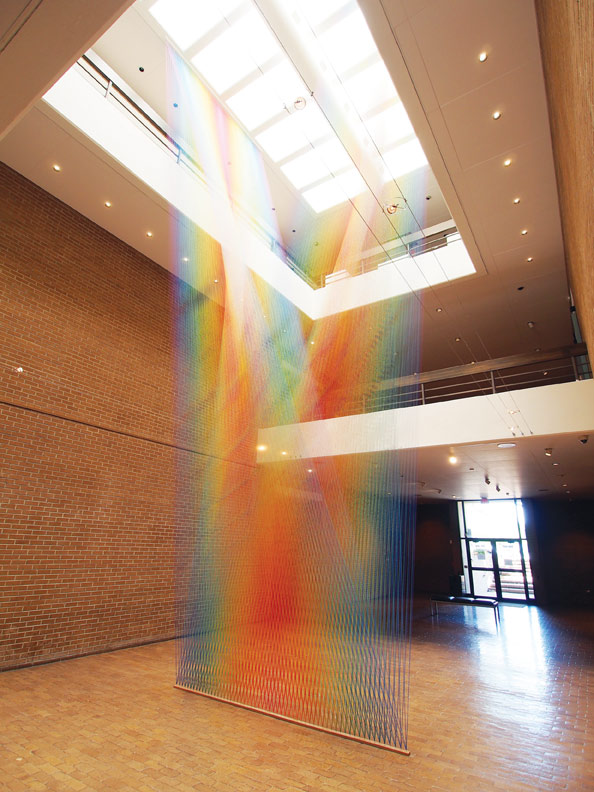 Gabriel Dawe, Plexus No. 33, 2016, multicolored thread, site-specific installation at the Amarillo Museum of Art, Amarillo, TX.