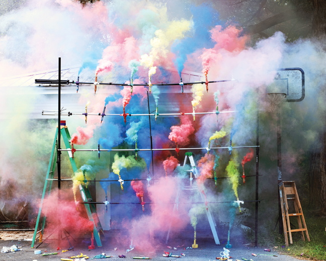 "Olaf Breuning, Smoke Bombs 2, 2011, mounted C-print on 6mm sintra, 49 1/8"" x 61."" Courtesy of the artist and Metro Pictures, New York."